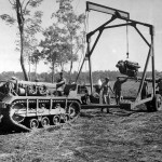 Removing engine from a P-40 Dobodura New Guinea