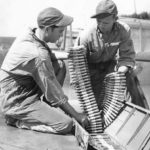 Crew loading ammo into wing mg of P-40 Oahu 1942