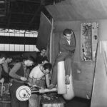 Employees at Curtiss-Wright working on P-40 landing gear '41
