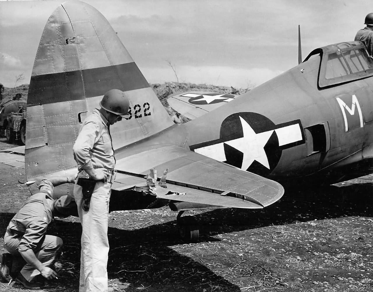 """Damaged P-47 """"M"""" 43-25322 """"Super Paduzi"""" of the 19th Fighter Squadron, 318th Fighter Group Saipan"""