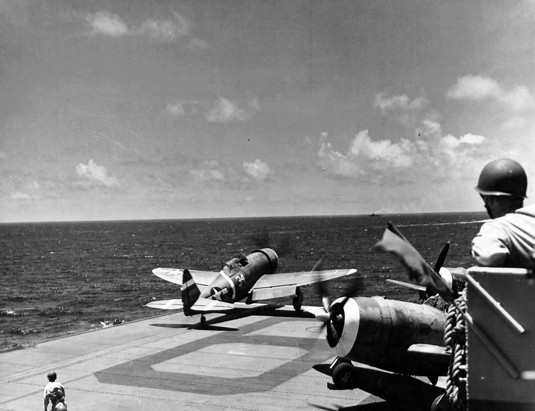 P-47 Thunderbolt #34 of the 73rd Fighter Squadron, 318th Fighter Group takes off from the USS Manila Bay CVE-61