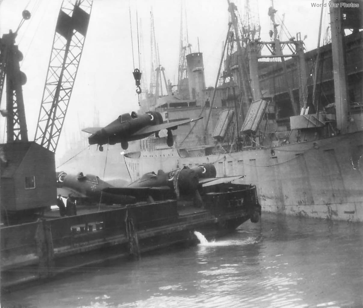 P-47 Hoisted from Liberty Ship Enroute to Airfield in England