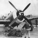 353rd FG crew loads 500lbs bomb on P-47 at RAF Metfield 43