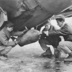 Crewmen loading 500 bomb on P-47 England 43