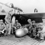 Ground Crew Ready To Attach Drop Tank To P-51 D Mustang code LC-X of the 20th FG 77th Fighter Squadron