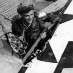 21 December 1944 – lt Henehan of the 346th FS, 350th Fighter Group stands in the hole in his P-47 left wing