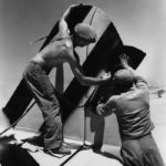 318th Fighter Group crew paint tail markings onto a P-47 Thunderbolt