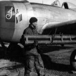 "Armorer installs rocket tubes onto a ""Tish VII"" P-47D W3-F from 313th FS, 50th FG"