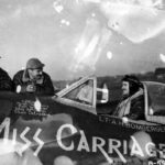 "CAPT Amos Bomberger II of the 361st FS, 356th FG in the cockpit of his P-47D 42-26649 ""Miss Carriage"""