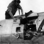 Col Ray J. Stecker of the 365th Fighter Group inspects a flak hole in his P-47 Azeville (A-7) France 1944