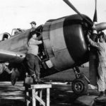 Ground crew carry out checks and maintenance work on P-47D-30-RE Thunderbolt, code HV-X 44-20626