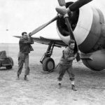 Ground crew of the 78th Fighter Group manually start the engine of a P-47 1943