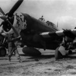 "Ground personnel of the 358th FG prepare to start the engine of a P-47 Thunderbolt ""Chunky"""