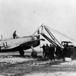 P-47D of the 22nd FS, 36th Fighter Group is extricated from the mud of Le Culot airfield A-89 Belgium December 1944