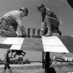 Armorers of the 366th FG service the weapons on a P-47 Thunderbolt at St Pierre du Mont airfield A-1, June 1944