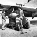 Loading 1000lb bomb on a P-47 of the 201st Mexican FS Porac Airstrip Philippine Islands – 26 June 1945