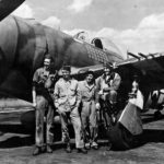 ltCol Gabreski of the 61st FS, 56th Fighter Group stands with the ground crew