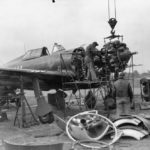 mechanics removing the engine from a P-47 at Duxford September 1943