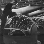 Plexiglass domes of machine gun turrets being readied for PBMs