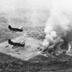 Helldivers bomb installations at Omura Kyushu 1945
