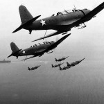 SB2U Vindicators 41-S-12 and 41-S-10 of VS 41 in formation over USS Ranger CV-4 1942