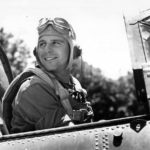 USMC pilot Charles Fink of VMSB-244 after 55th combat mission in cockpit SBD-5