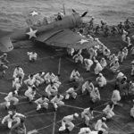 SBD sailors duck walk for exercise aboard carrier Dauntless