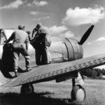 USAAC ground crew talking to pilot on a A-24 oct41