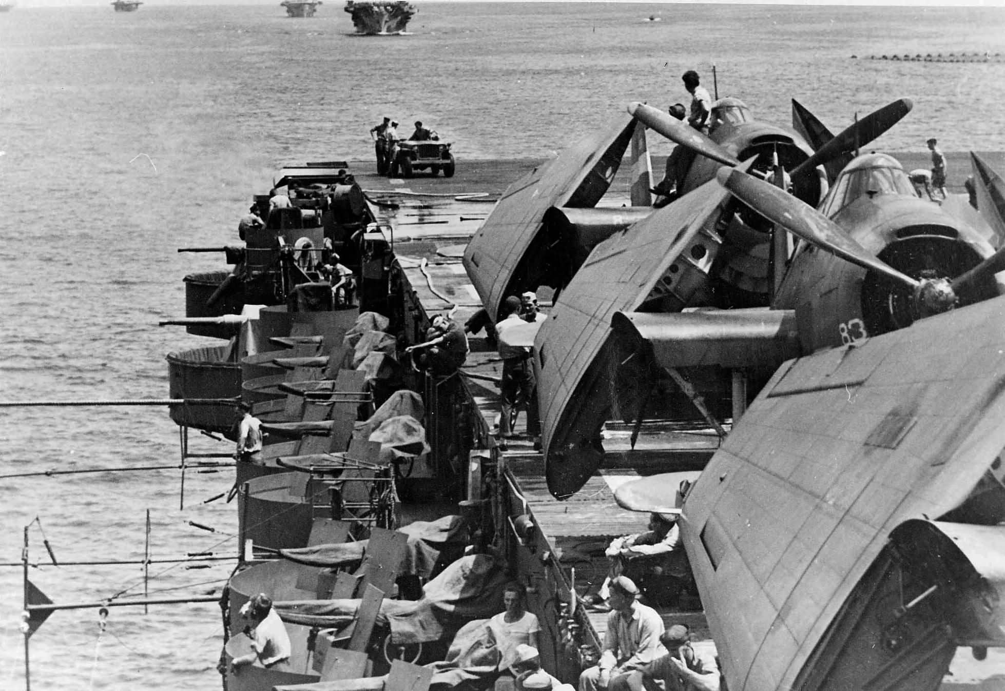 Escort carrier USS Sangamon (CVE-26) with TBM-1C Avengers of Torpedo Squadron VT-37 pictured spotted on the flight deck in 1944