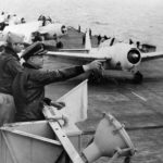 Capt Isbell, Cmdr Snider and Avengers takeoff from USS Card 1943