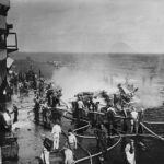 Crew Fight Fire of Burning TBM Avenger piloted by Lt. C.R. Dean of VT-124 on Deck of USS HANCOCK 21 January 1945 2