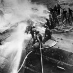 Crew Fight Fire of Burning TBM Avenger piloted by Lt. C.R. Dean of VT-124 on Deck of USS HANCOCK (CV-19) – 21 January 1945
