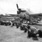 Crew loads 500 lb bombs on TBF at Guadalcanals Henderson Field