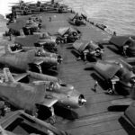 F6F-3 Hellcats and TBM-1C white 2 and 3 on the flight deck of the USS Bataan, Hawaii July 20 1944