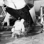 Loading a Mark XIII torpedo into the bomb bay of a TBF-1 USS Lexington 2