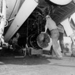 Ordnancemen load Mk 10 mines into the bomb bay of a TBF Avenger VT-16 on the flight deck of the carrier USS Lexington (CV-16) on March 29, 1944