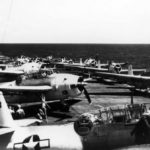 TBF-1C Avenger of the VC-6 painted in the Atlantic paint scheme of light gray and white pictured on the flight deck of the USS Tripoli CVE-64