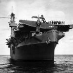 TBF Avenger hangs on carrier s bow after overrunning flight deck