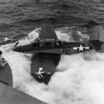 TBF Avenger #22 in water alongside USS Coral Sea
