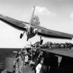 Grumman TBF of VT-31 drifts over the port catwalk of the carrier USS Cabot (CVL-28) – December 1943
