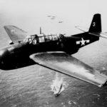 TBM-3E Avenger #3 of VT-33 in flight over USS Sangamon March 2,7 1945
