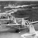 TBM Avengers and FM Wildcats of VC-36 on the flight deck of the USS Core CVE-13 Atlantic on April 9, 1944