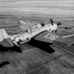 TBM Avenger code E16 of Carrier Aircraft Service Unit CASU-22 onto catapult on board the escort carrier USS Mission Bay (CVE-59) on October 23, 1943