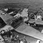 """TBM Avenger """"21"""" of VC-42 into other aircraft spotted on the forward section of the flight deck of the escort carrier Bogue (CVE-9) during flight operations on September 18 1944"""
