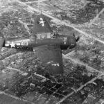 "TBM-3 Avenger #413 of VT-83 ""Cultured Vulture II"" USS Essex in flight over Japan August 1945"