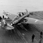 Damaged TBM-3 #301 of VT-84 after it landed aboard the carrier USS Bunker Hill (CV-17) February 19, 1945