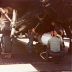 Crewmen load a Mark XIII torpedo on a TBM Avenger USS Bennington CV-20