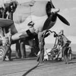 refuel a TBF-1 Avenger of VT-4 on the flight deck of the USS Ranger during Operation Torch November 8 1942