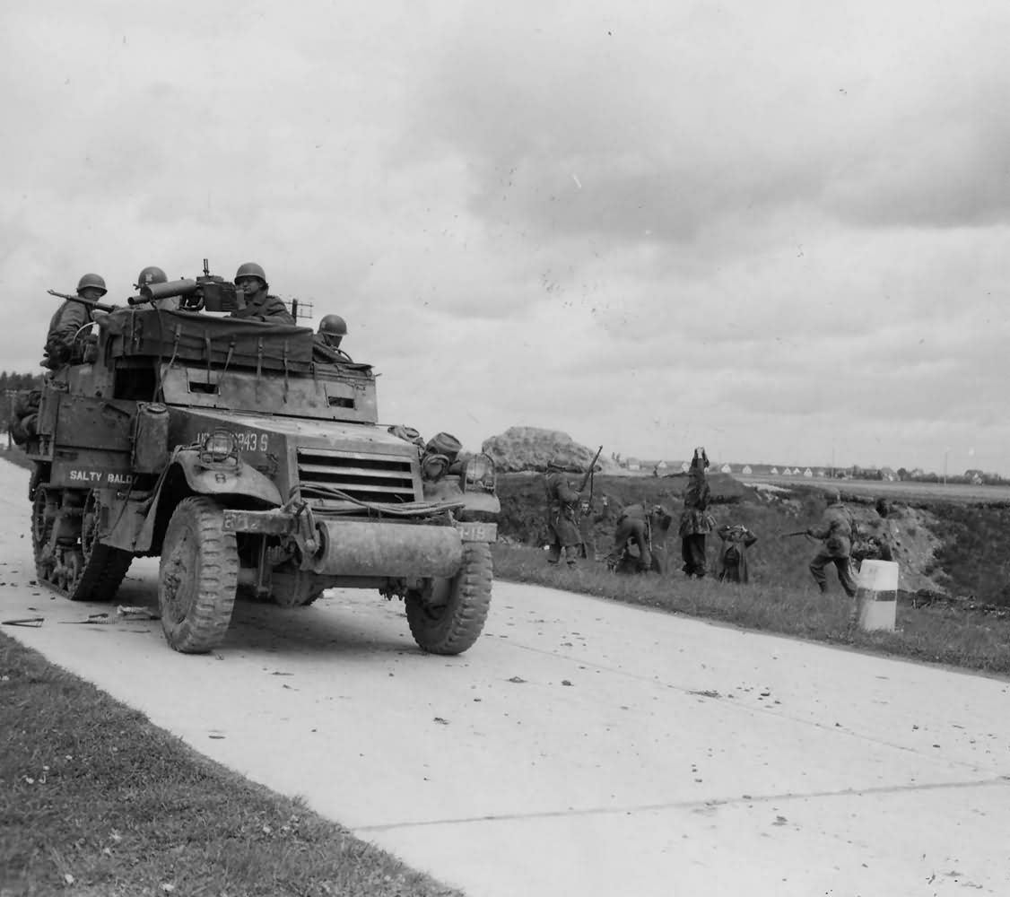 M3A1 halftrack of 3rd Infantry Division and 20th Armored Division Takes POWs Munich Germany 1945