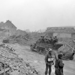 1st Army MP and M3 Halftracks with trailers in Ruins of Alterkirchen Germany 1945